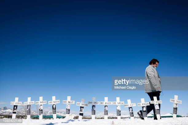 Tyler Vielie walks past crosses with the names of the victims of the Columbine High School shooting next to the Columbine Memorial on April 20, 2021...
