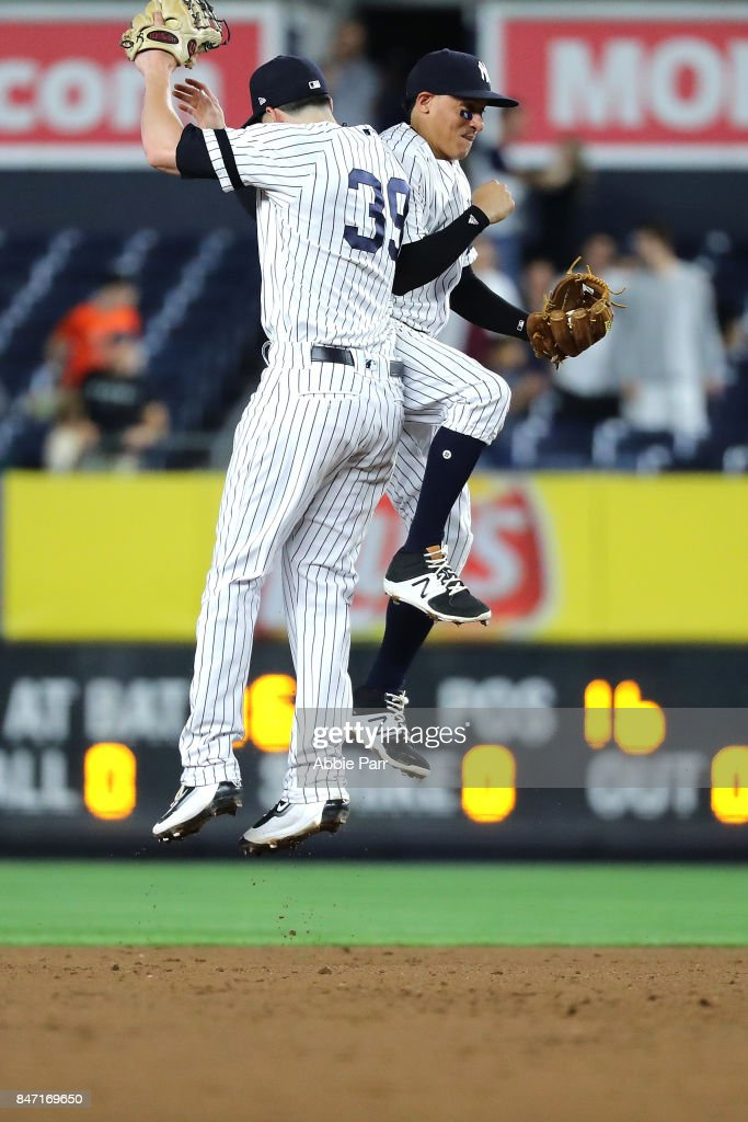 Tyler Wade #39 and Ronald Torreys #74 of the New York Yankees celebrate after a 13-5 win against the Baltimore Orioles at Yankee Stadium on September 14, 2017 in the Bronx Borough of New York City.