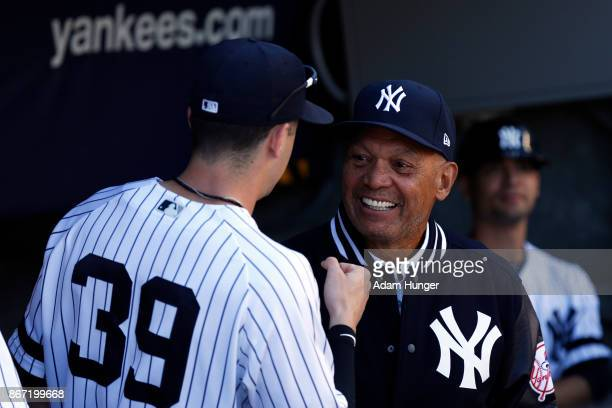 Tyler Wade of the New York Yankees fist bumps Reggie Jackson former New York Yankees prior to a game against the Toronto Blue Jays at Yankee Stadium...