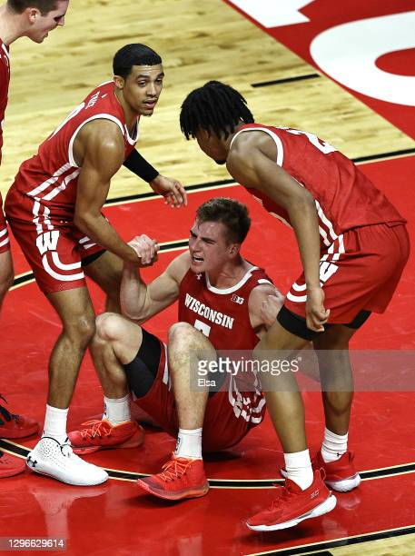 Tyler Wahl of the Wisconsin Badgers celebrates after he drew the foul late in the second half against the Rutgers Scarlet Knights at Rutgers Athletic...