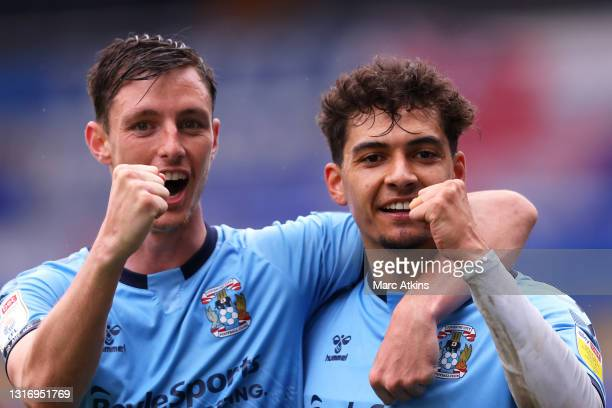 Tyler Walker of Coventry City celebrates after scoring their team's sixth goal with Matthew James during the Sky Bet Championship match between...