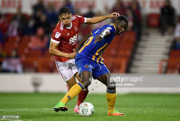 Tyler Walker of Nottingham Forest and Aristote Nsiala of Shrewsbury during the Carabao Cup First Round match between Nottingham Forest and Shrewsbury...