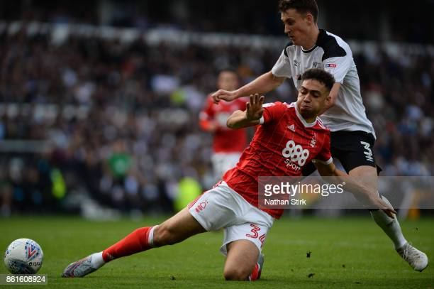 Tyler Walker of Nottingham Forest and Craig Forsyth of Derby in action during the Sky Bet Championship match between Derby County and Nottingham...