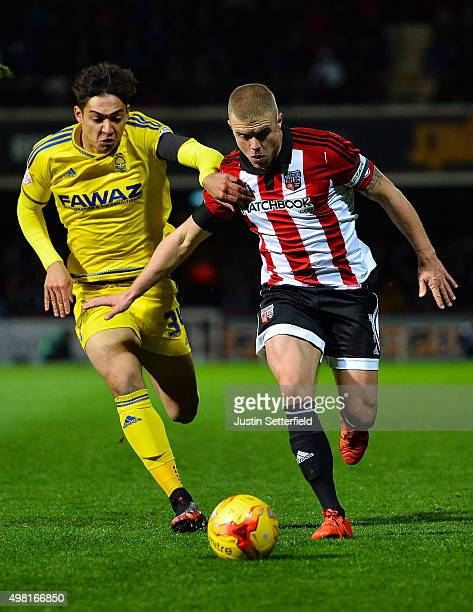 Tyler Walker of Nottingham Forest and Jake Bidwell of Brentford during the Sky Bet Championship match between Brentford and Nottingham Forest at...