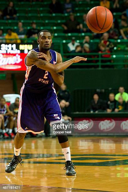 Tyler Washington of the Northwestern State Demons makes a pass against the Baylor Bears on December 18 2013 at the Ferrell Center in Waco Texas