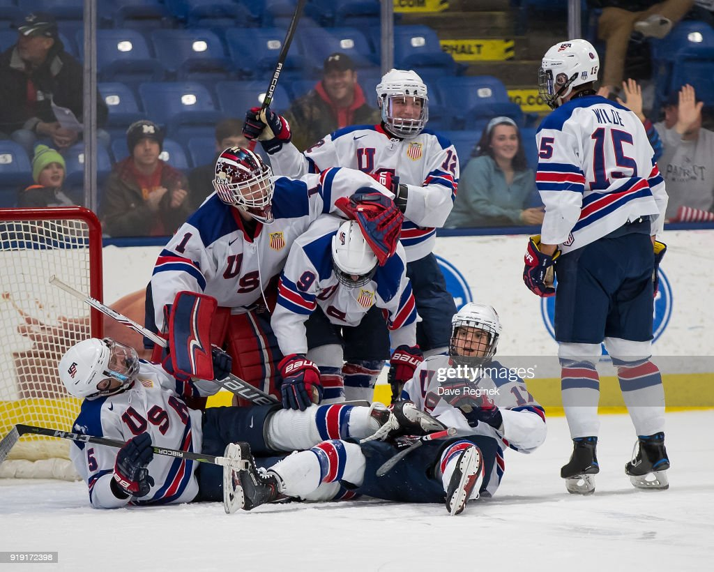 Tyler Weiss #9 of the USA Nationals is surrounded by teammates after scoring the game winning goal late in the third period during the 2018 Under-18 Five Nations Tournament game against the Russian Nationals against the Russian Nationals at USA Hockey Arena on February 16, 2018 in Plymouth, Michigan. The USA defeated Russia 5-4.