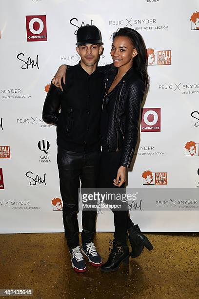 Tyler White and Symon Leone attend the Pejic x Snyder Jewelry Line Launch Party at Gilded Lily on April 3 2014 in New York City