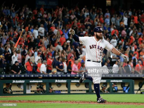 Tyler White of the Houston Astros hits a walkoff home run in the ninth inning to beat the Oakland Athletics 54 at Minute Maid Park on August 29 2018...