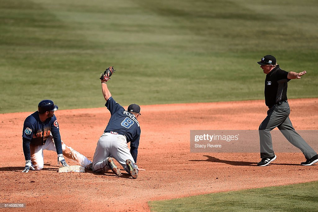 Tyler White #84 of the Houston Astros slides into second base to beat a tag by Jace Peterson #8 of the Atlanta Braves during the fourth inning of a spring training game at Osceola County Stadium on March 9, 2016 in Kissimmee, Florida.