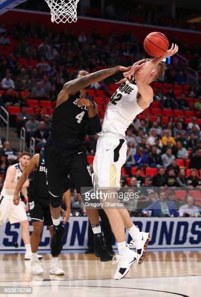 Tyler Wideman of the Butler Bulldogs blocks a shot by Matt Haarms of the Purdue Boilermakers during the first half in the second round of the 2018...