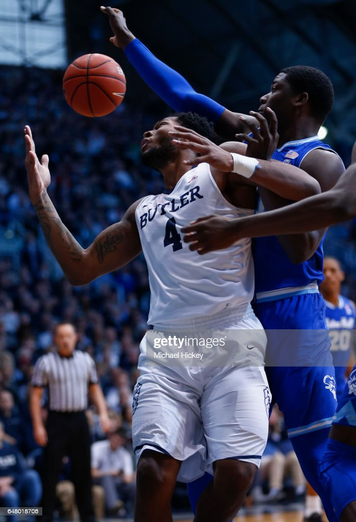 Tyler Wideman #4 of the Butler Bulldogs fights for the rebound with Angel Delgado #31 of the Seton Hall Pirates at Hinkle Fieldhouse on March 4, 2017 in Indianapolis, Indiana.