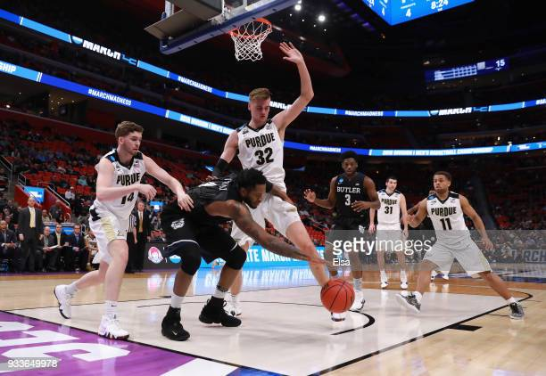 Tyler Wideman of the Butler Bulldogs rebounds the ball against Ryan Cline and Matt Haarms of the Purdue Boilermakers during the first half in the...