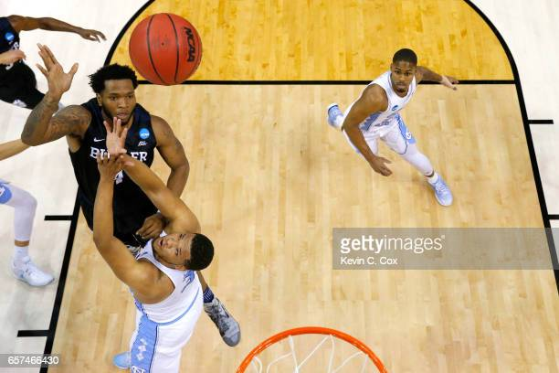Tyler Wideman of the Butler Bulldogs shoots against Kennedy Meeks of the North Carolina Tar Heels in the first half during the 2017 NCAA Men's...