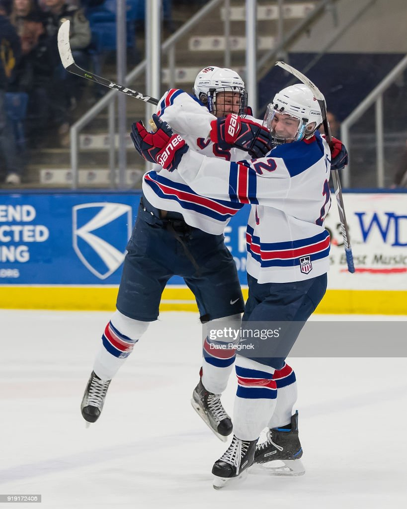 Tyler Wiess #9 of the USA Nationals celebrates the game winning goal with teammate Jake Wise #12 goal during the 2018 Under-18 Five Nations Tournament game against the Russian Nationals at USA Hockey Arena on February 16, 2018 in Plymouth, Michigan. The USA defeated Russia 5-4.