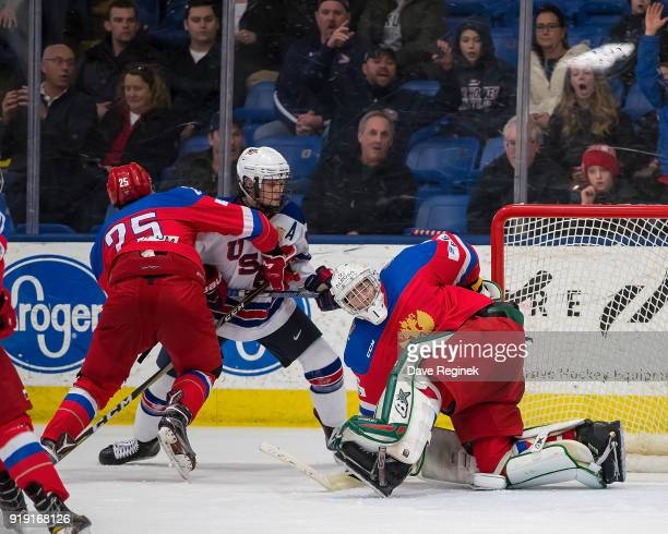 Tyler Wiess of the USA Nationals scores the game winning goal late in the third period on Amir Miftakhof of the Russian Nationals as Jonathan Gruden...