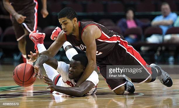 Tyler Williams of the Brown Bears fouls Zavion Williams of the Austin Peay Governors as they go after a loose ball during the 2014 Continental Tire...