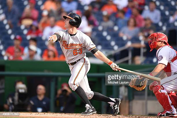 Tyler Wilson of the Baltimore Orioles takes a swing during a baseball game against the Washington Nationals at Nationals Park on September 24, 2015...