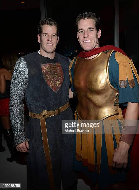 Tyler Winklevoss and Cameron Winklevoss attend the Treats Magazine Annual Halloween Party at a private residence on October 31 2012 in Los Angeles...