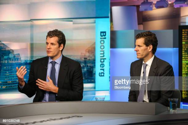 Tyler Winklevoss chief executive officer and cofounder of Gemini left speaks as Cameron Winklevoss president and cofounder of Gemini listens during a...