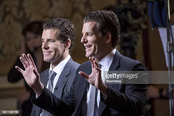 Tyler Winklevoss, chief financial officer and co-founder of Gemini Trust Company LLC, right, speaks as Cameron Winklevoss, chief executive officer...