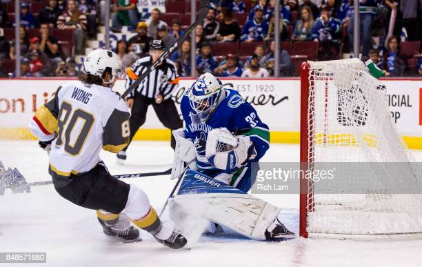 Tyler Wong of the Las Vegas Golden Knights scores against goalie Richard Backman of the Vancouver Canucks in NHL preseason action on September 17...