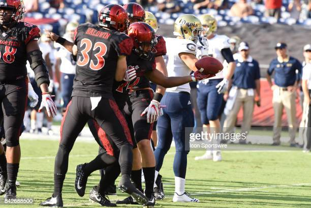 SDSU Tyler Wormhoudt intercepts a pass and celebrates with SDSU Parker Baldwin during the college football game between UC Davis Aggies and San Diego...