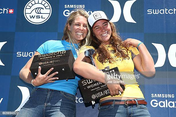 Tyler Wright and Stephanie Gilmore pose with their trophies at the 2016 Swatch Women's Pro at Trestles at San Onofre State Beach on September 14 2016...