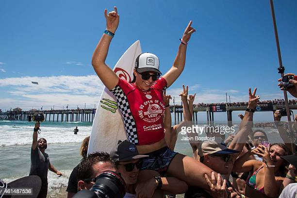 Tyler Wright celebrates with friend family and fans after winning during the final round of the women's surfing main event during the last day of the...