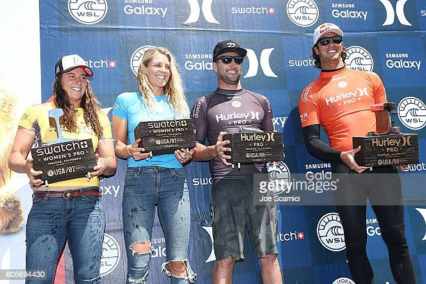 Tyler Wright Stephanie Gilmore and Joel Parkinson all of Australia and Jordy Smith of South Africa pose with their tropies at the end of the 2016...