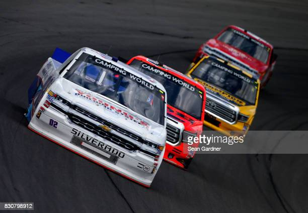 Tyler Young driver of the Randco/Young's Building Systems Chevrolet leads a pack of trucks during the NASCAR Camping World Truck Series LTi Printing...
