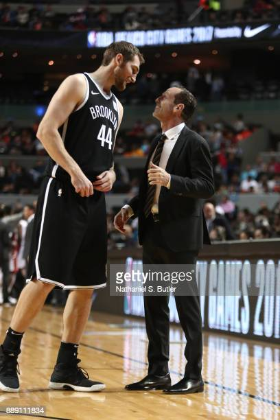 Tyler Zeller and Head Coach Kenny Atkinson of the Brooklyn Nets talk during the game against the Miami Heat as part of the NBA Mexico Games 2017 on...