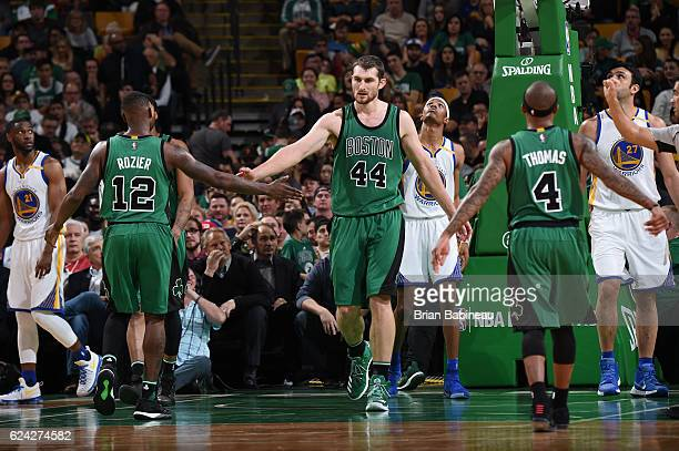 Tyler Zeller and Terry Rozier of the Boston Celtics highfive during a game against the Golden State Warriors on November 18 2016 at TD Garden in...