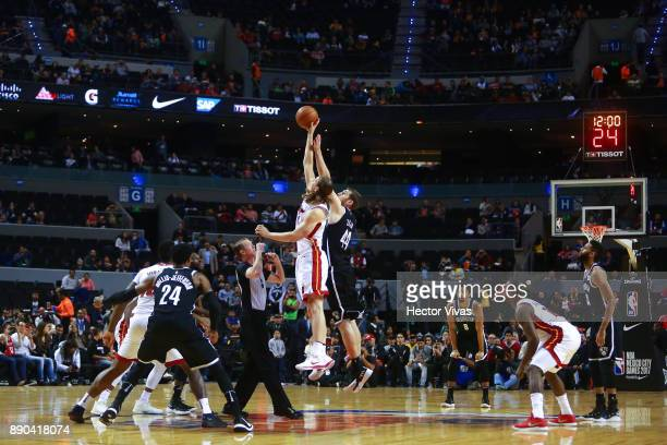 Tyler Zeller of Brooklyn Nets jumps for the ball in the initial jump with Kelly Olynyk of Miami Heat during the NBA game between the Brooklyn Nets...