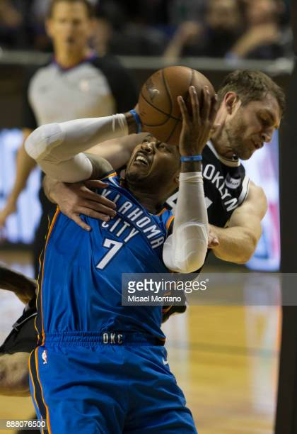 Tyler Zeller of Nets blocks the ball Carmelo Anthony of Thunder during the NBA match between Brooklyn Nets and Oklahoma City Thunder at Arena Ciudad...