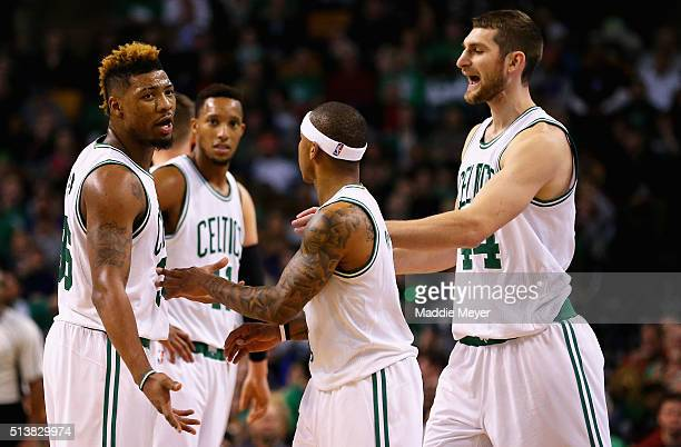 Tyler Zeller of the Boston Celtics and Isaiah Thomas talk with Marcus Smart after a foul is called against him during the third quarter against the...