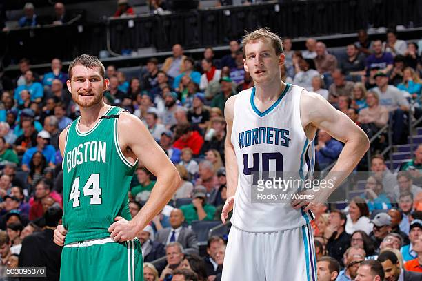 Tyler Zeller of the Boston Celtics faces off against Cody Zeller of the Charlotte Hornets on December 23 2015 at Time Warner Cable Arena in Charlotte...