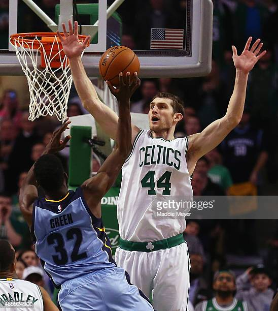 Tyler Zeller of the Boston Celtics jumps to block a shot by Jeff Green of the Memphis Grizzlies during the fourth quarter at TD Garden on March 11...