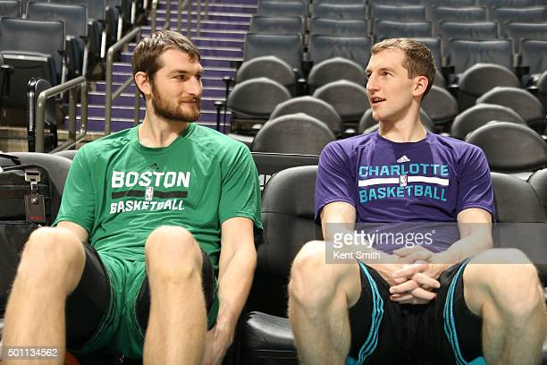 Tyler Zeller of the Boston Celtics spends some time with brother Cody Zeller of the Charlotte Hornets before the game at the Time Warner Cable Arena...