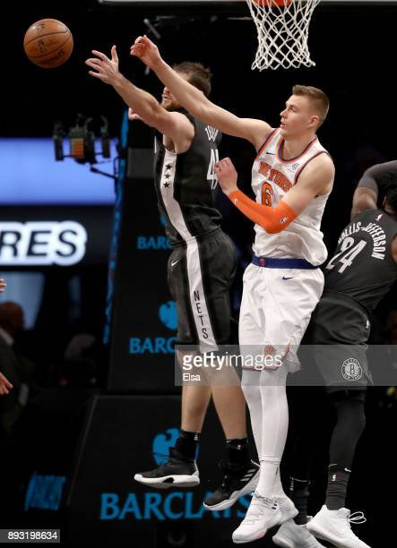 Tyler Zeller of the Brooklyn Nets and Kristaps Porzingis of the New York Knicks fight for the ball in the third quarter at the Barclays Center on...