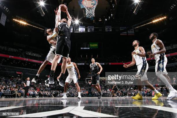 Tyler Zeller of the Brooklyn Nets drives to the basket against the Denver Nuggets on October 29 2017 at Barclays Center in Brooklyn New York NOTE TO...