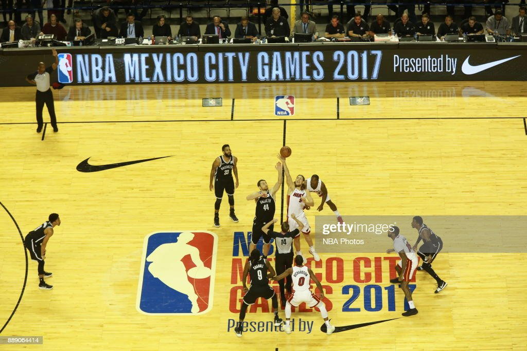 Tyler Zeller of the Brooklyn Nets jumps the opening tip against Kelly Olynyk of the Miami Heat as part of the NBA Mexico Games 2017 on December 9, 2017 at Mexico City Arena in Mexico City, Mexico.