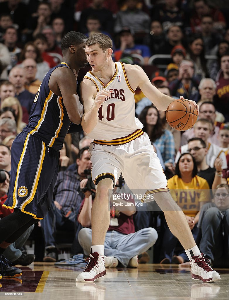 Tyler Zeller #40 of the Cleveland Cavaliers backs in towards the basket against Roy Hibbert #55 of the Indiana Pacers at The Quicken Loans Arena on December 21, 2012 in Cleveland, Ohio.