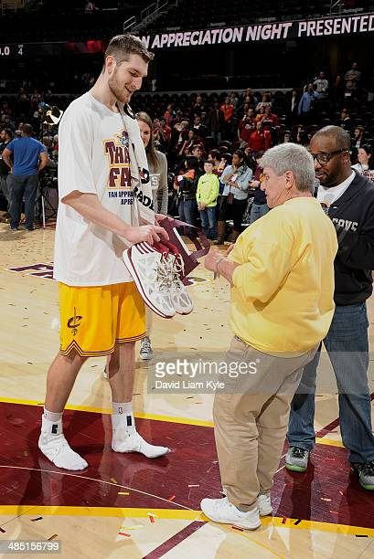 Tyler Zeller of the Cleveland Cavaliers gives his game shoes to a fan on Fan Appreciation Night after the game against the Brooklyn Nets at The...