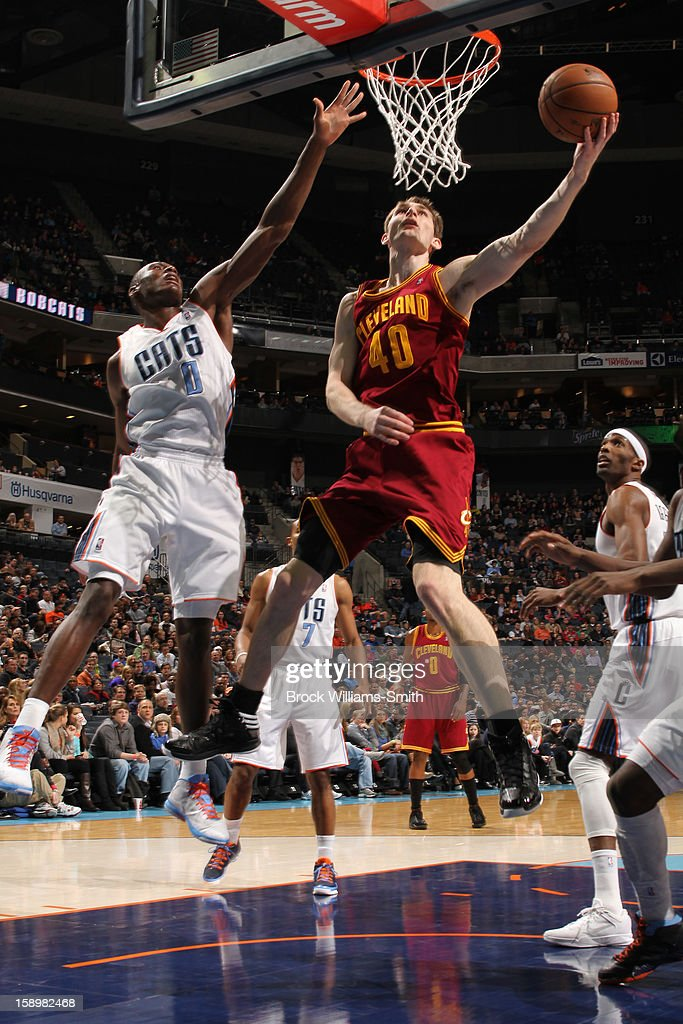 Tyler Zeller #40 of the Cleveland Cavaliers shoots against Bismack Biyombo #0 of the Charlotte Bobcats at the Time Warner Cable Arena on January 4, 2013 in Charlotte, North Carolina.