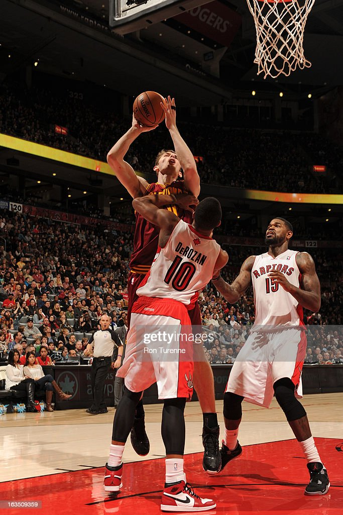 Tyler Zeller #40 of the Cleveland Cavaliers shoots against DeMar DeRozan #10 of the Toronto Raptors on March 10, 2013 at the Air Canada Centre in Toronto, Ontario, Canada.