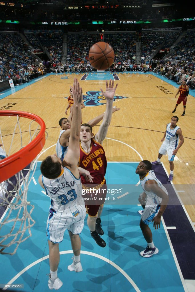 Tyler Zeller #40 of the Cleveland Cavaliers shoots against Ryan Anderson #33 of the New Orleans Hornets on March 31, 2013 at the New Orleans Arena in New Orleans, Louisiana.
