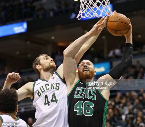 Tyler Zeller of the Milwaukee Bucks blocks a shot by Aron Baynes of the Boston Celtics but gets called for a foul during Game Four of Round One of...