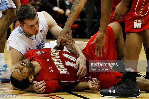 Tyler Zeller of the North Carolina Tar Heels and Sean Mosley of the Maryland Terrapins fall to the court as Zeller fouls Mosley in the second half...