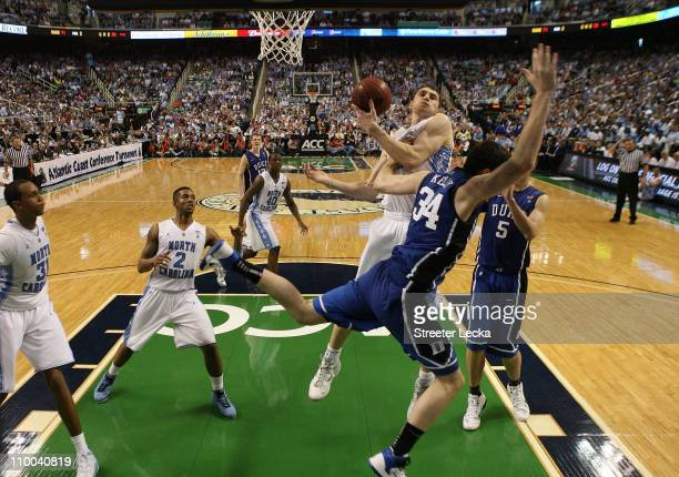 Tyler Zeller of the North Carolina Tar Heels battles for the ball against Ryan Kelly of the Duke Blue Devils during the second half in the...