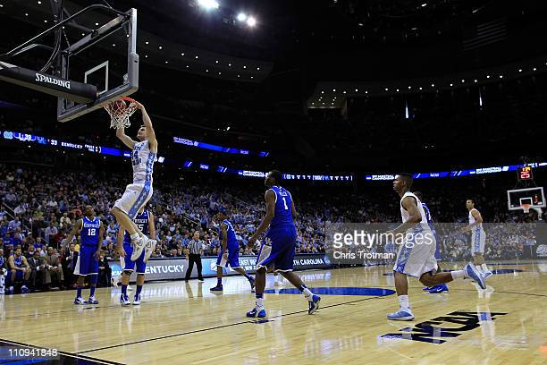 Tyler Zeller of the North Carolina Tar Heels dunks the ball against the Kentucky Wildcats during the first half of the east regional final of the...